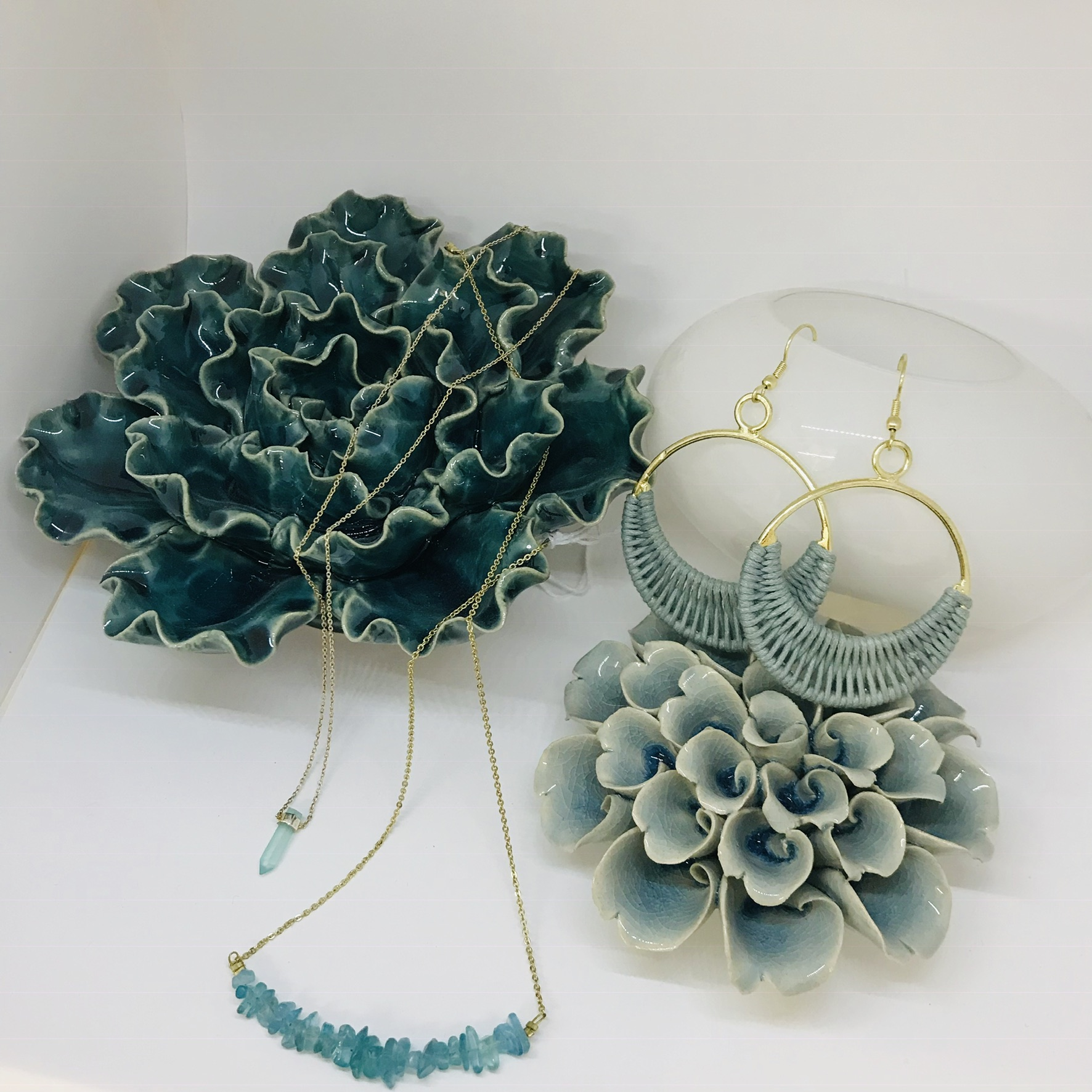 Gifts for your Wife - At DOMAIN, gifts for your wife are easy. We will help you pick out beautiful fair trade jewelry that fits all sizes, gorgeous ceramic flower succulents, and top it off with a single rose in a tabletop planter