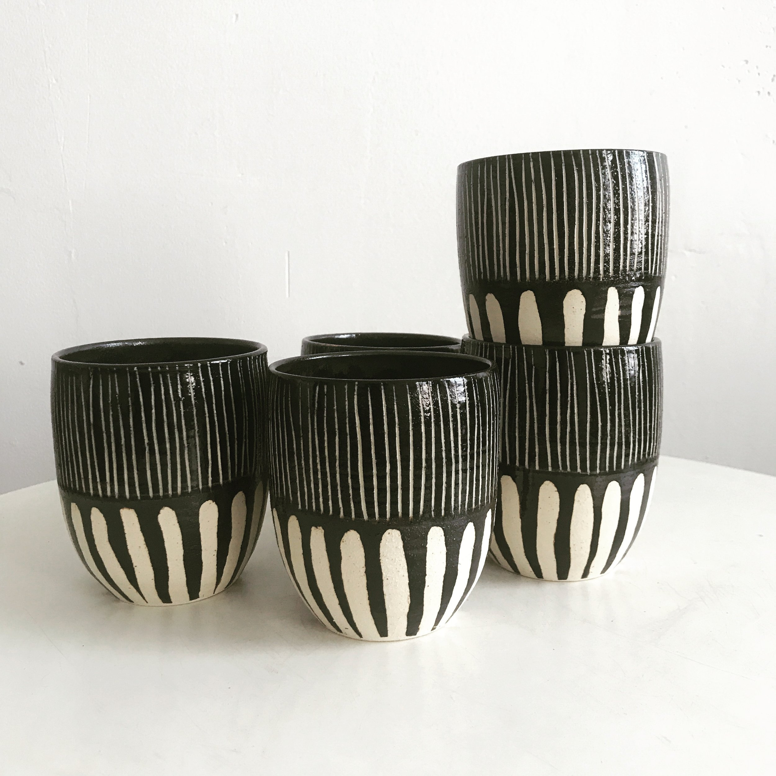 #2: Black & White Decorative Mug - Perfect for drinks or he can use it to hold pens on his desk.