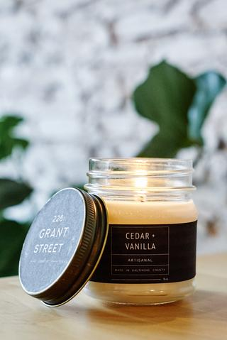 228 Grant Street Candles - A warm blend of cedar and vanilla blended with the hearty, oak notes of patchouli. Smells divine and it's made in Baltimore.