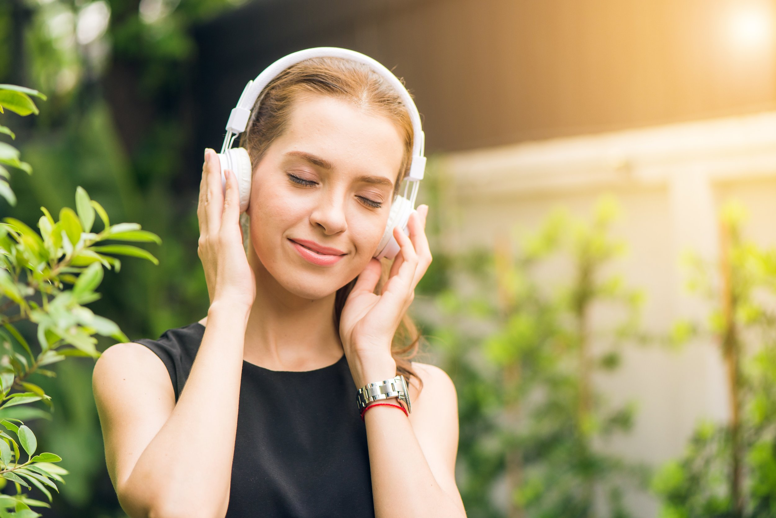 blond-woman-listening-headphones.jpg