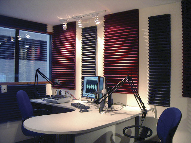 A recording studio with Auralex foam panelling.