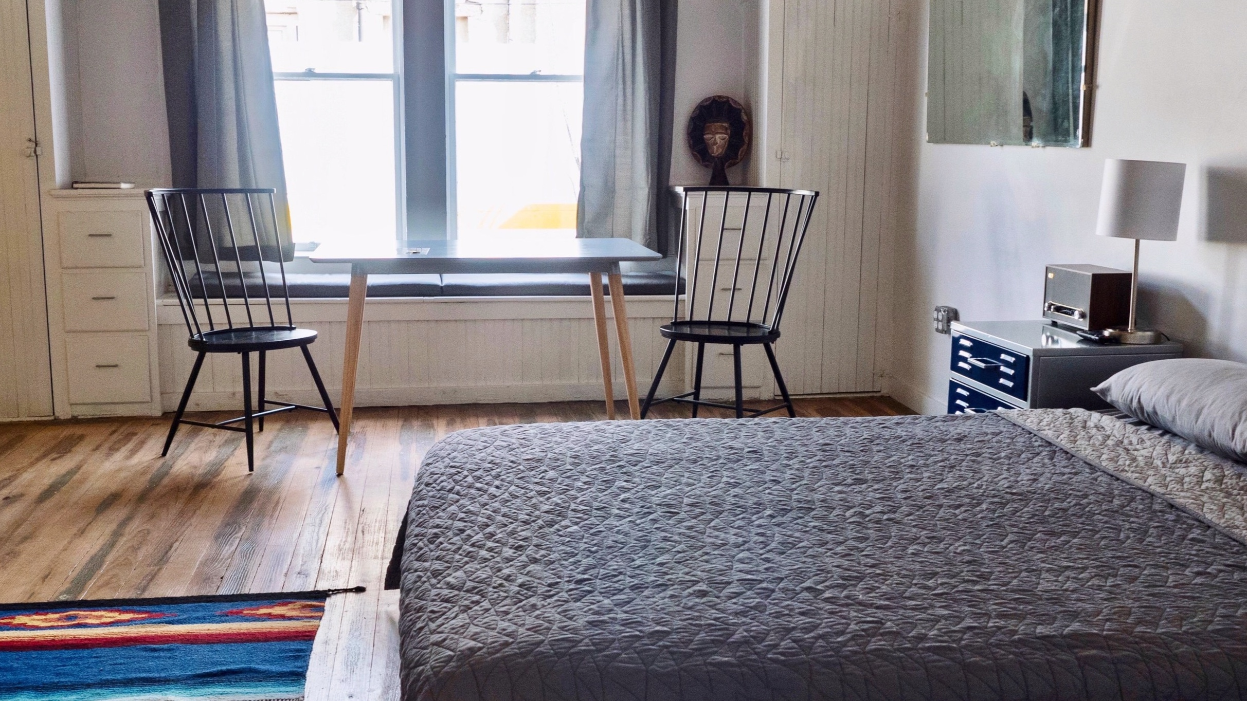 NUMBER 6 has original hardwood floors and original shiplap ceiling. Contemplate an eclectic variety of art throughout. Accommodates 2 guests. -
