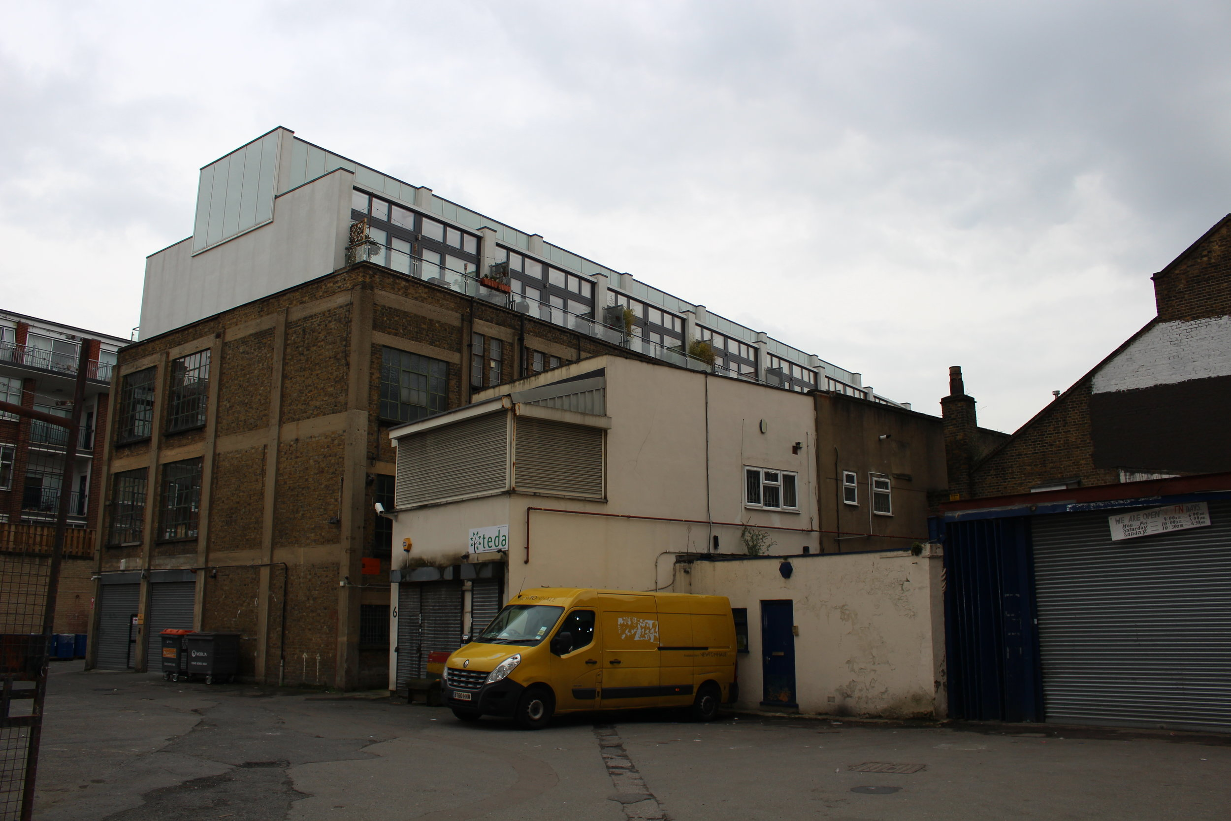 New housing looming over this industrial yard in Hackney London.JPG