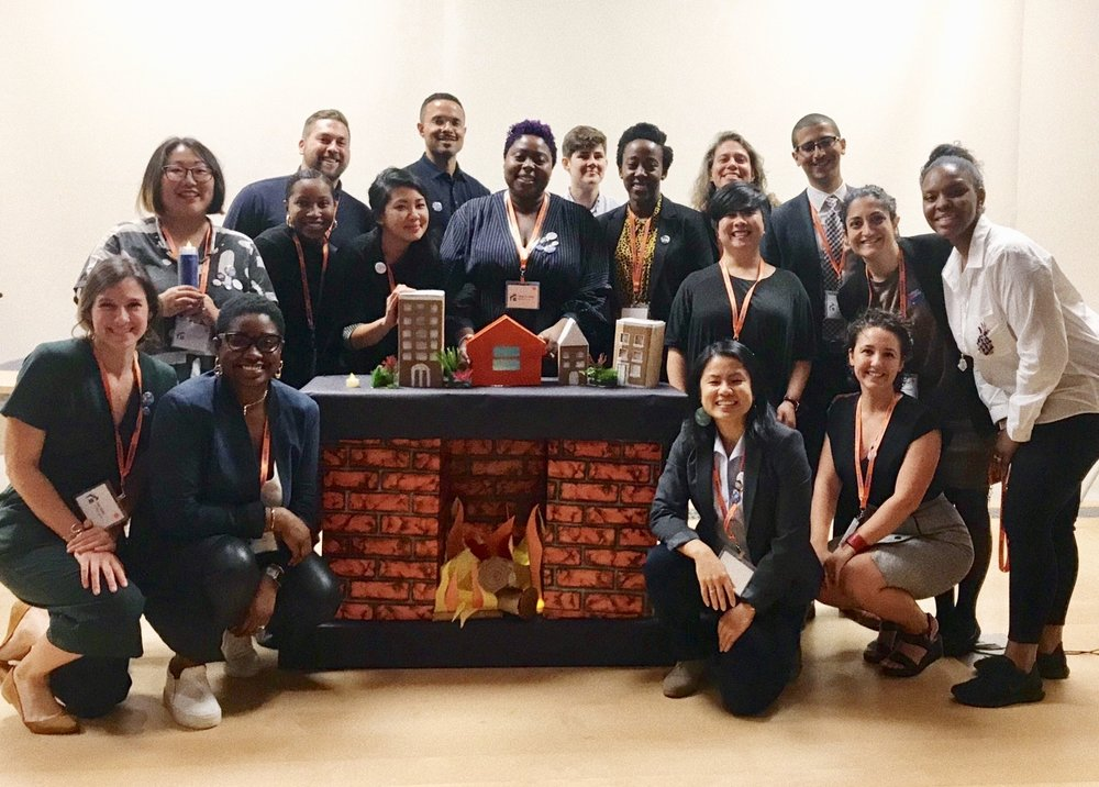 DivComm planning committee for Hindsight 2018 and their hand made fireplace for the keynote fireside chat