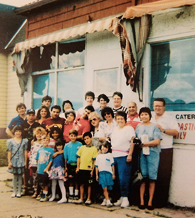 Leah & family in front of Range Catering in Virginia, MN. Owned and operated by her great-grandma Grace Ceryance for 35 years.