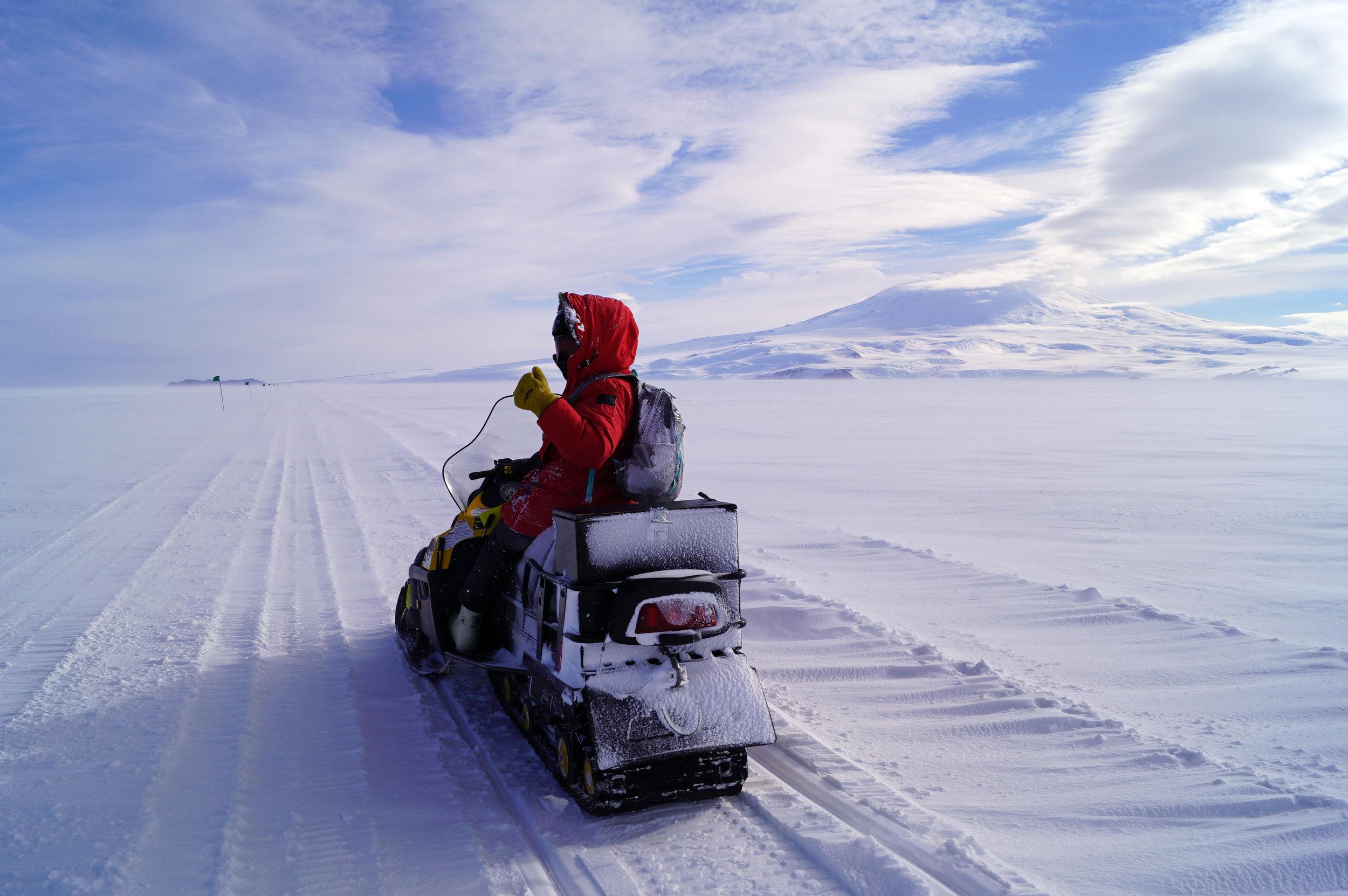 Snow machining on the sea ice. Photo credit: Elaine Hood.