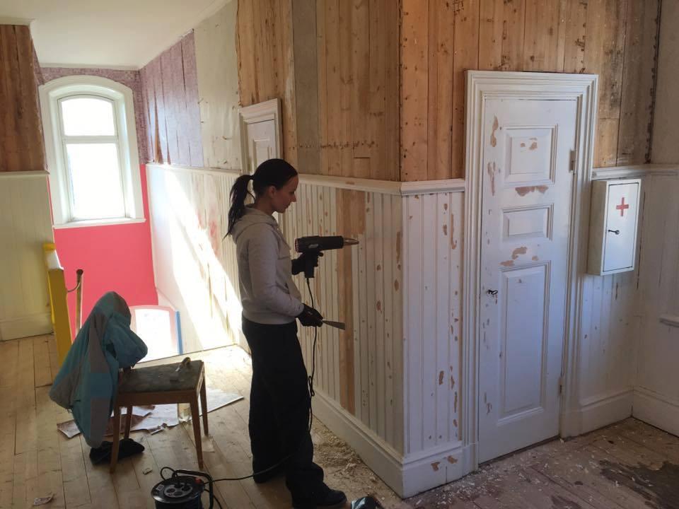helsinglight renovation wall scraping.jpg