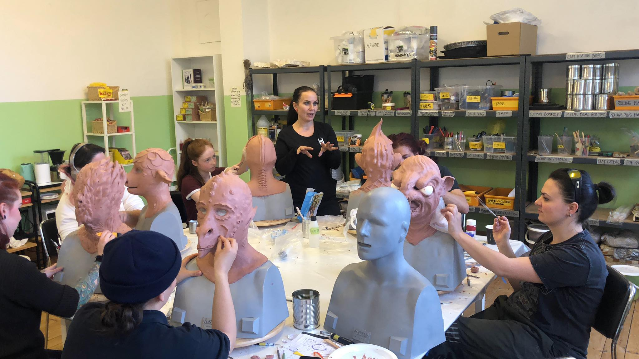 Students learning how to sculpt their fantasy creatures in clay during our 10-day mask making workshop