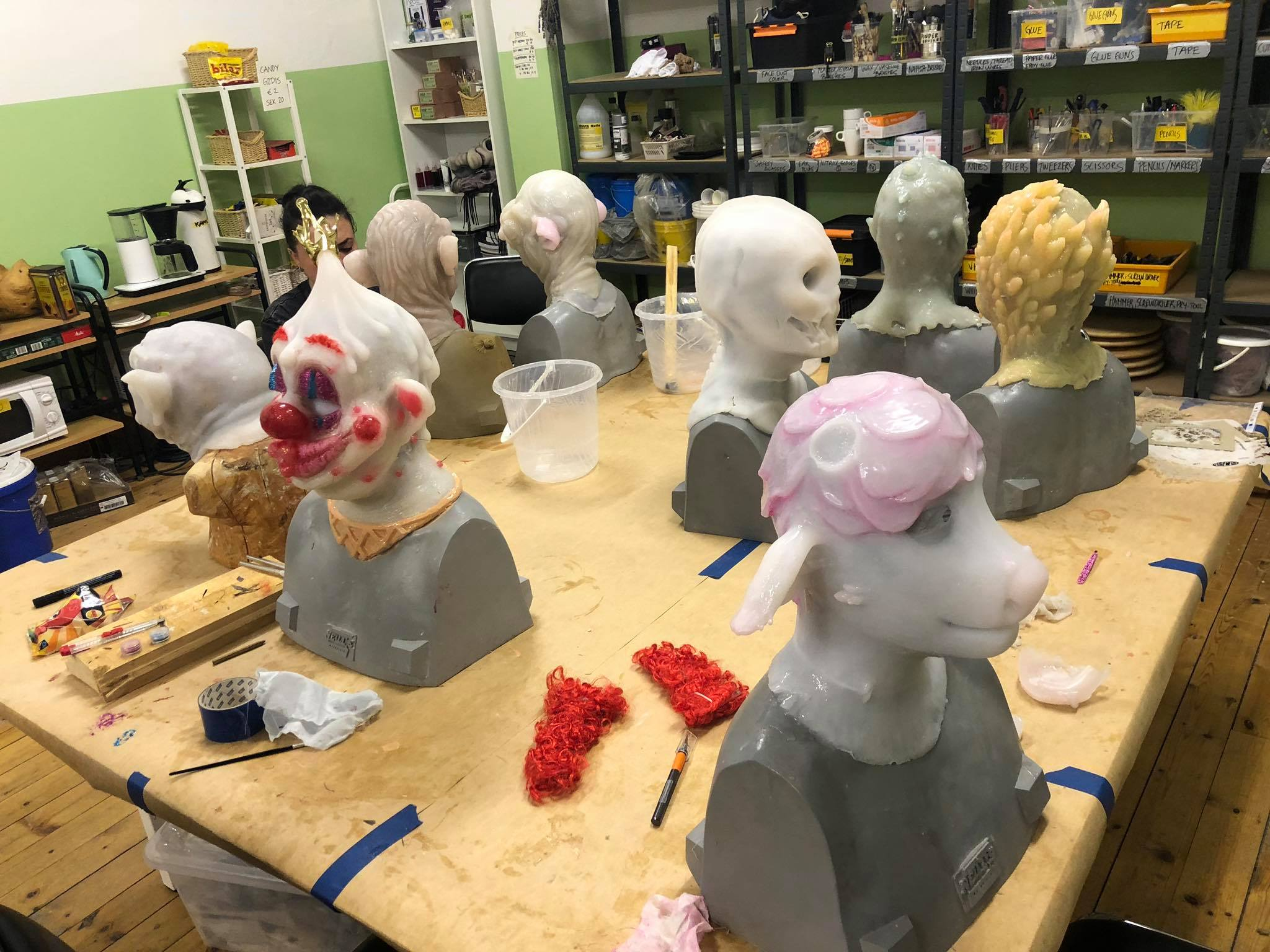 Students working on painting their silicone masks they've created during the 10-day mask making workshop