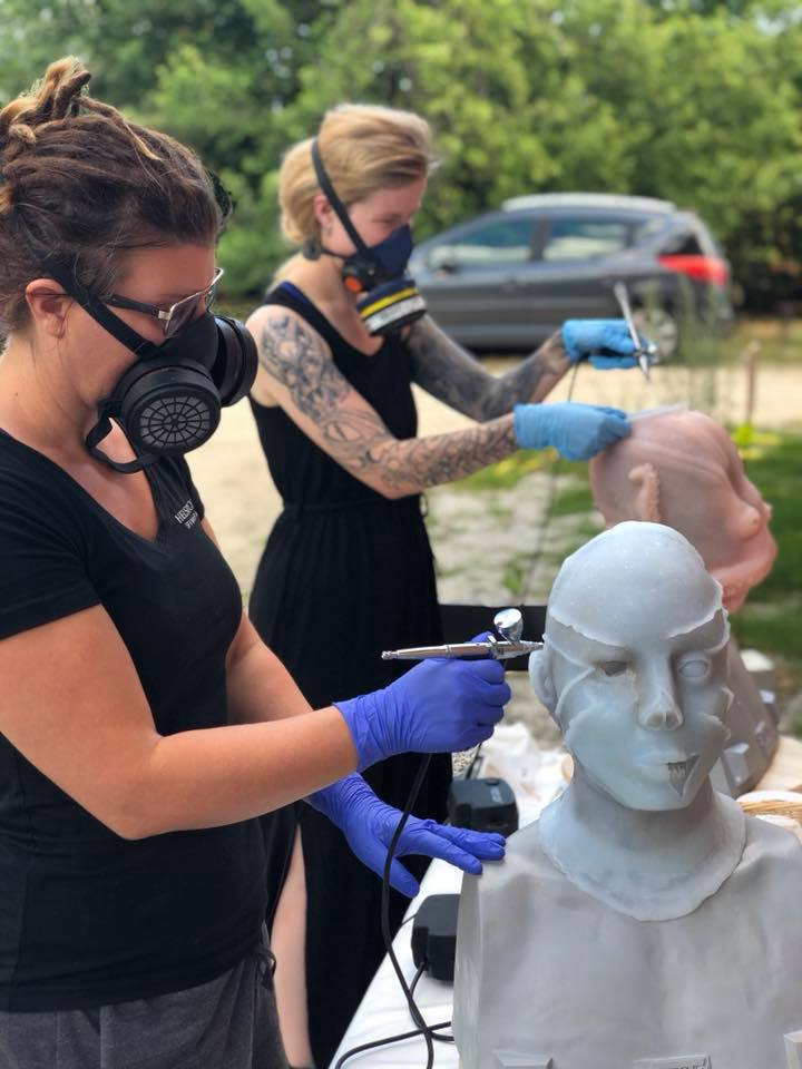 Students painting their silicone masks with airbrush during our 10-day mask making workshop at Helsinglight