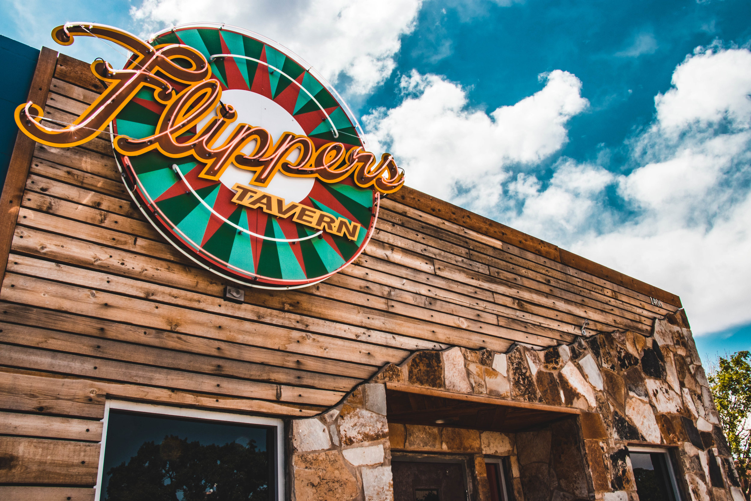 About Flippers Tavern - Pinball, Beer, and Brats are the name of the game. One of Lubbock's most eclectic dive spots you can actually find something for anyone from their classic pinball machines for the kids, killer brunch on Sundays, and even vegan options!