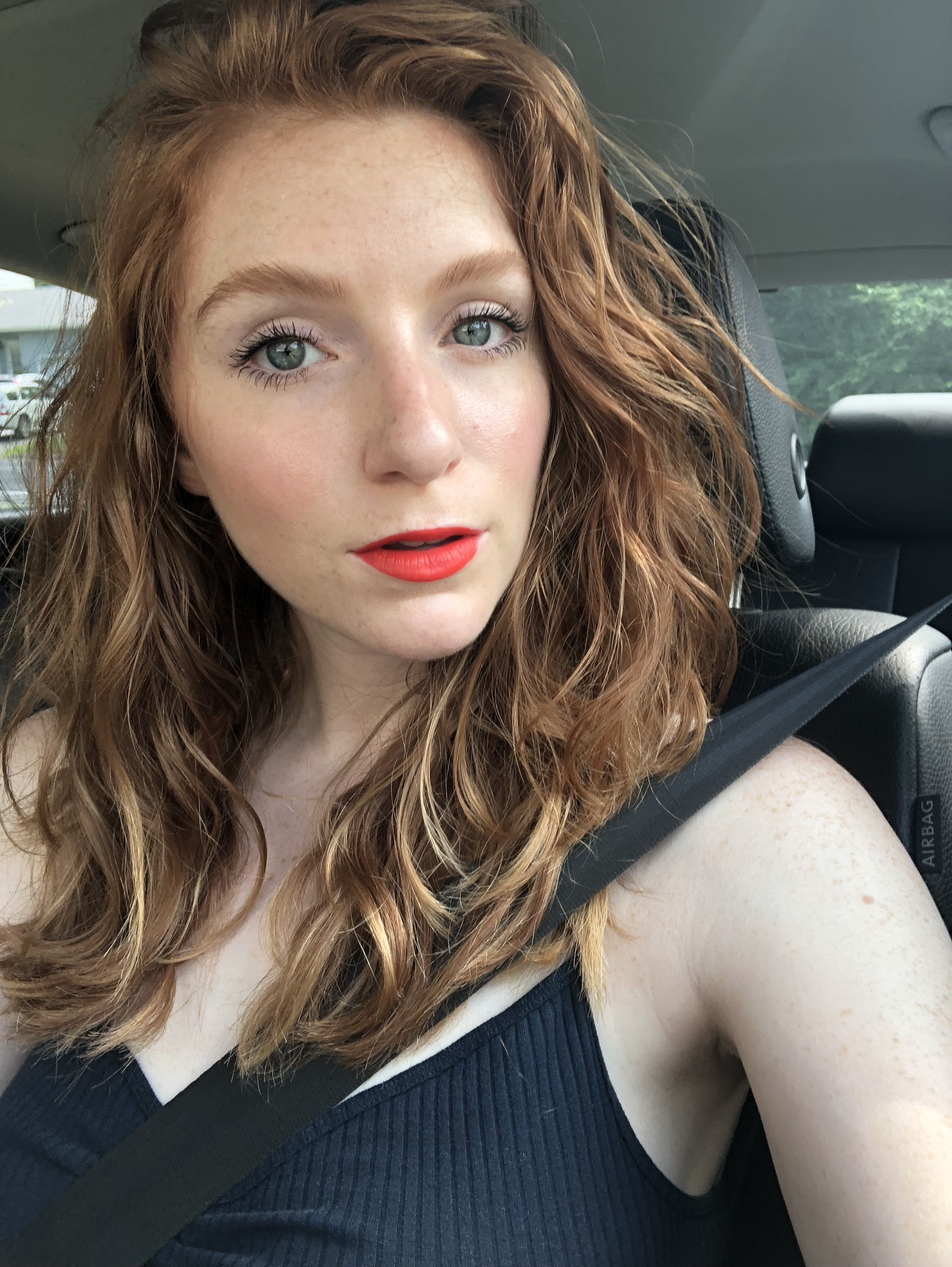 Car selfie in my 4th of July makeup ft. rosy cheeks in  Kjaer Weis Blush in Blossoming