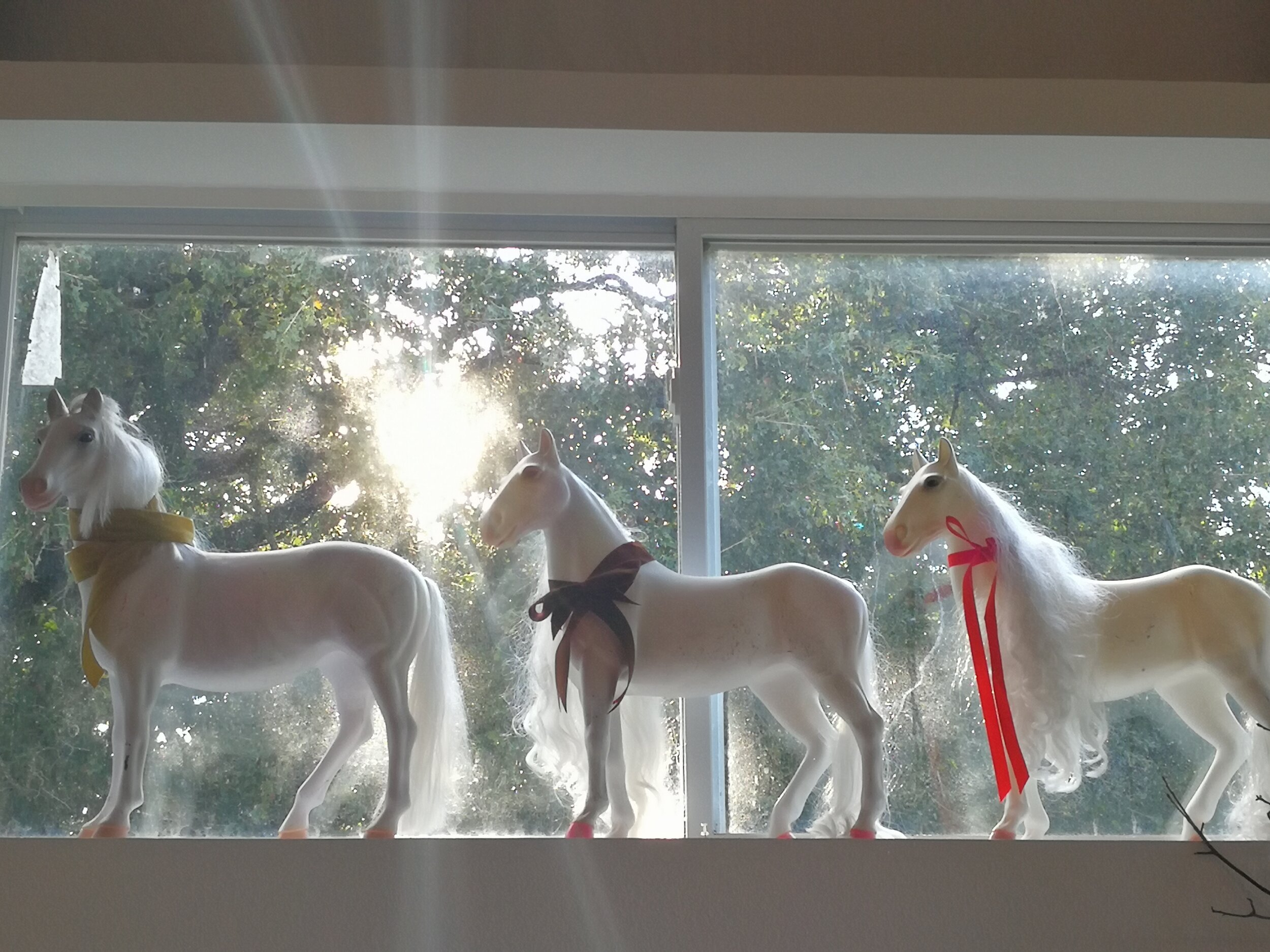 These are Piper's 3 favorite horses. We decided to give them velvet ribbons for autumn. They are L to R...Zeke, Starfire, and Lily. Starfire is Piper's favorite. She says Zeke and Lily are older and won't let Starfire play with them. Poor Starfire.