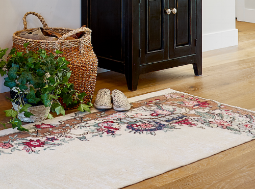We have really set the tone and colors of the home with this vintage runner.