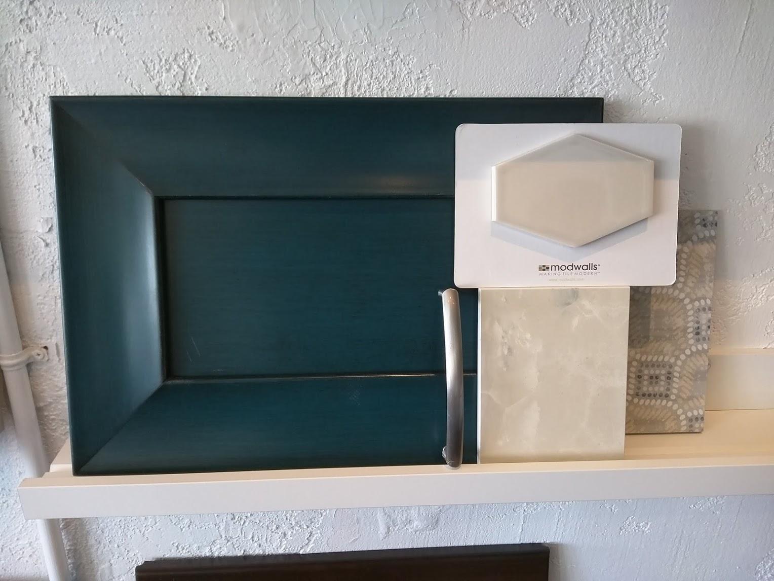 Sample display of cabinetry, wall tile/backsplash, flooring and countertop