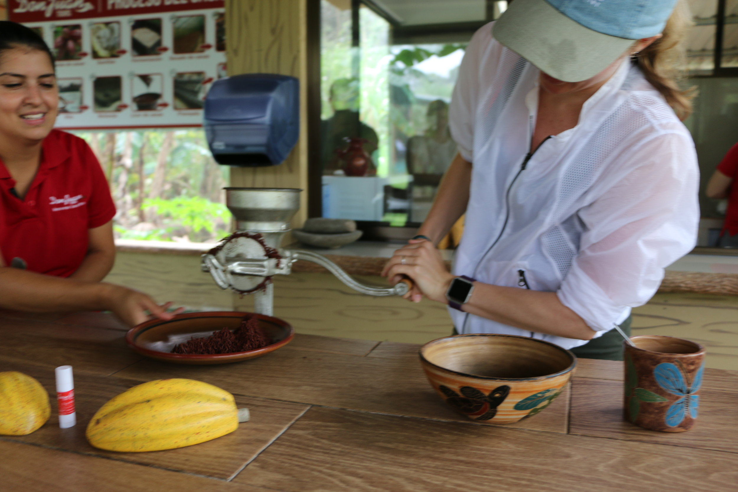 Me taking a crack at grinding the roasted cacao nibs into a paste to make all the chocolate-y goodness! Notice the tube of cacao butter next to the fruit - I definitely rubbed it all over my sun burned face.