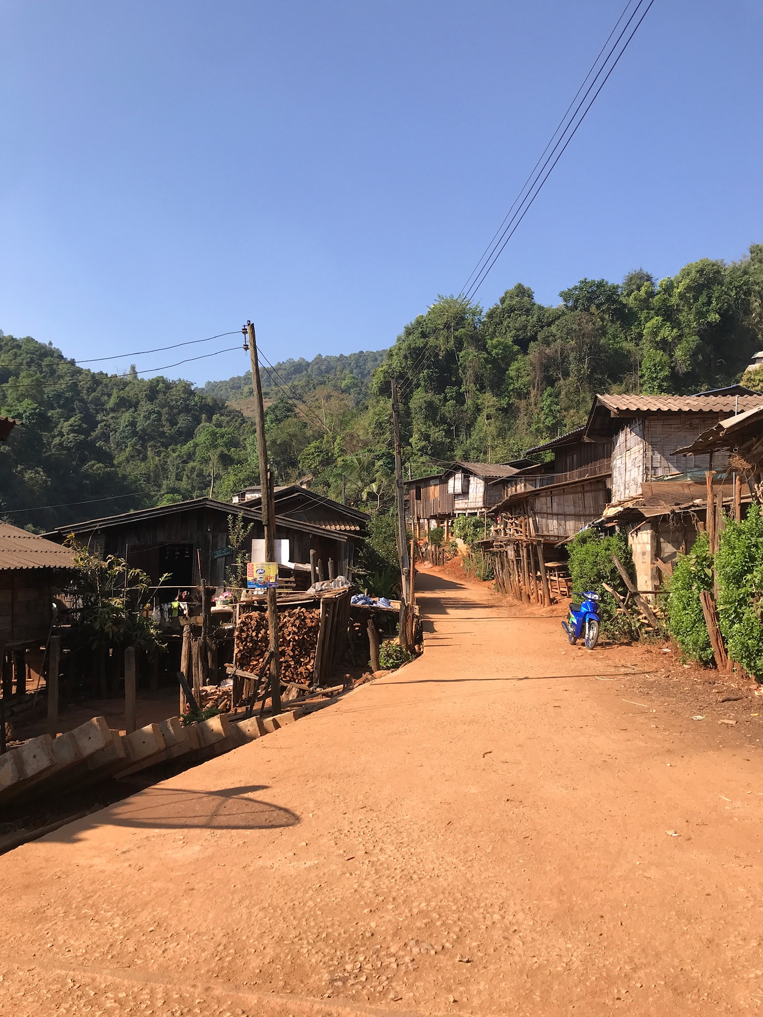 Our first view of our home in the Lahu Hill Tribe village, unloading our weary, happy selves and backpacks from the back of a pickup truck after a nauseating yet beautiful ride up winding mountains 2 hours north from Chiang Mai.