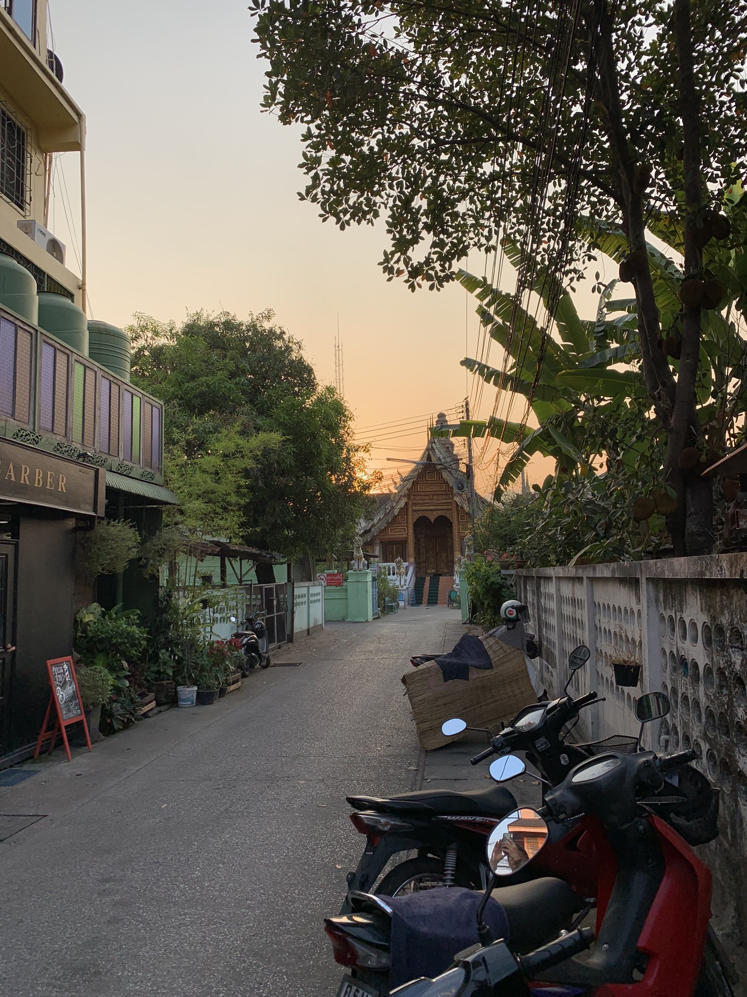 One of the many winding, narrow streets lined with scooters and graced with a temple at the end, as common as a coffee shop. I couldn't help but capture the sunset!