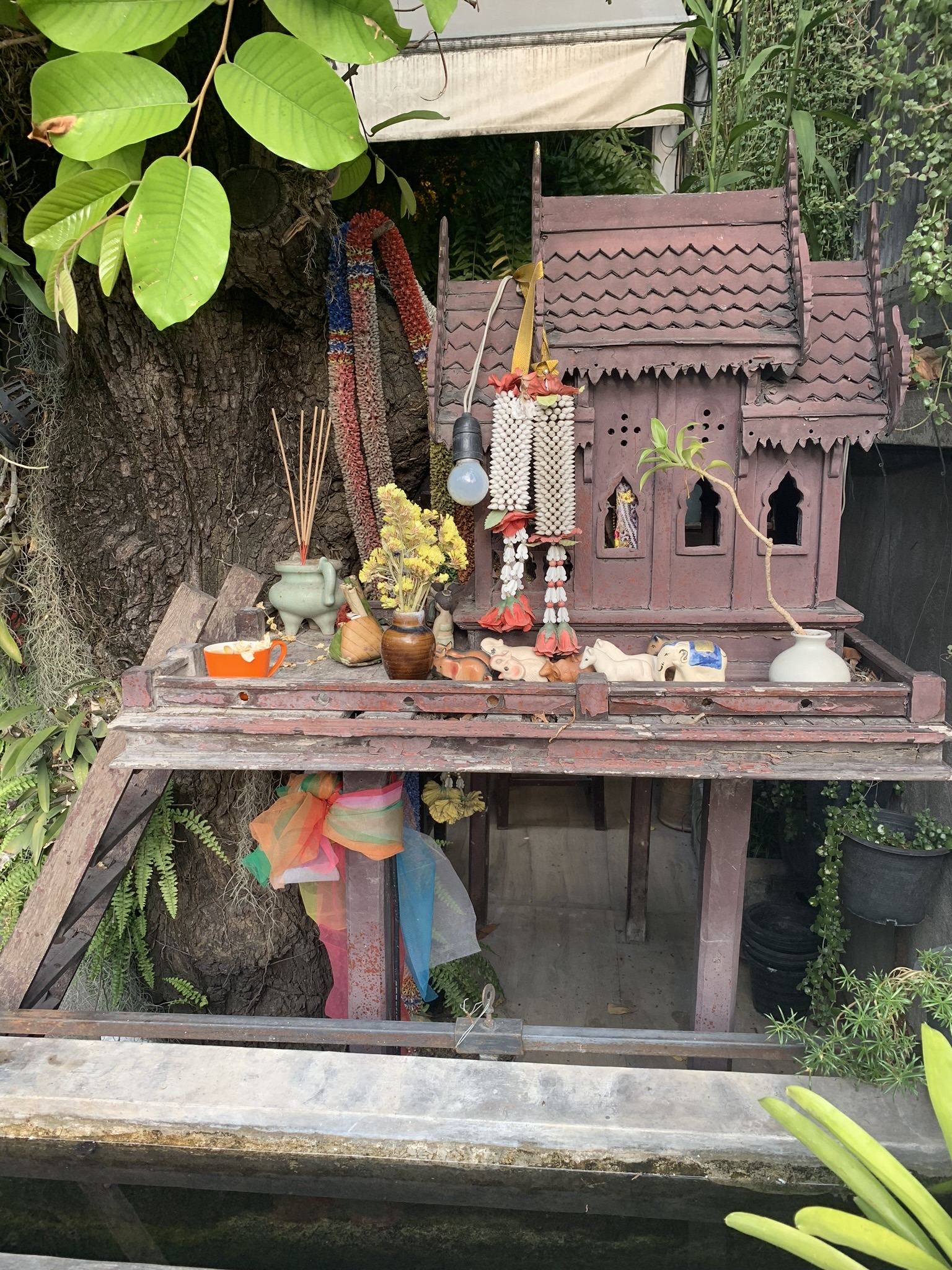 A miniature temple outside a restaurant on a bustling street where our hotel, Makkachiva, was located. Everyday the shop owners bring fresh flowers, adornments and light incense as offerings to the spirit world.