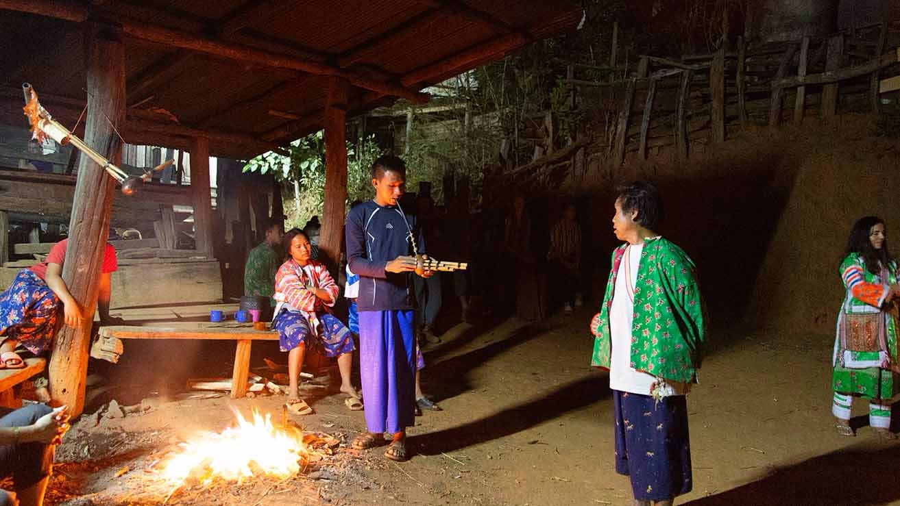 Lahu ceremony in the Dancing Circle, picturing the traditional flute-like instrument to which the dances were set. Also featuring traditional Lahu clothing, which many of us foreigners started wearing by the end of our stay.