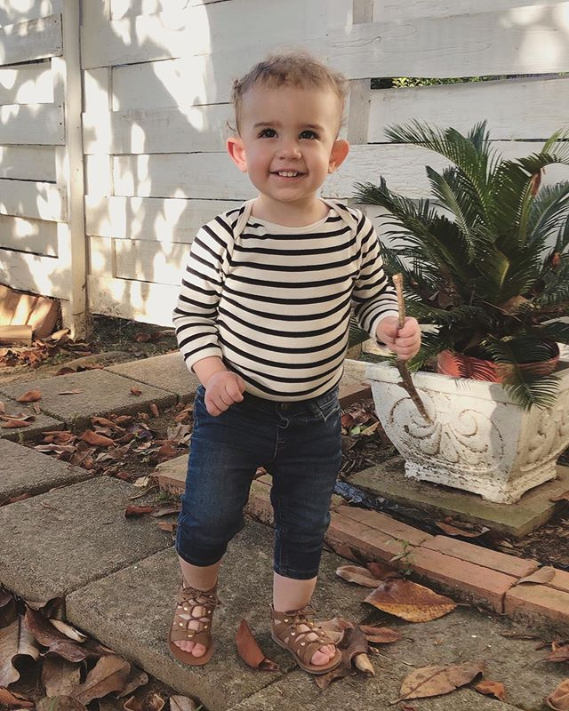 This is 18 months! Chatting up a storm, obsessed with going outside, loves pretending to be a kitty that eats guacamole🤷🏻‍♀️🤔, and all of the sudden she has curls. #delphineelyse