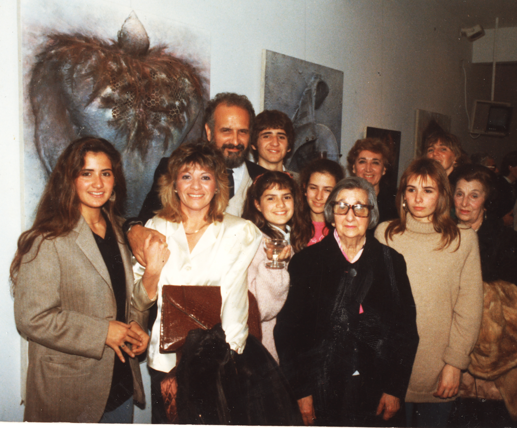 From left to right: my daughter Ivana Muriel Cardo; my first former wife Silvia Arenales; me; at my side, my son, Iara Gabriel Cardo; below him, my daughter Sabrina Sofía Cardo; at her side, my daughter Samanta Brenda Cardo; in the front, my mother, Blanca Esther Badde; to her right, my daughter Nuria Andrea Cardo; behind my mother, my sister, Edith Mabel Cardo Dodds; at her side, partially seen, her daughter, Janine Dodds; and at right, my aunt and godmother, Norma Badde.