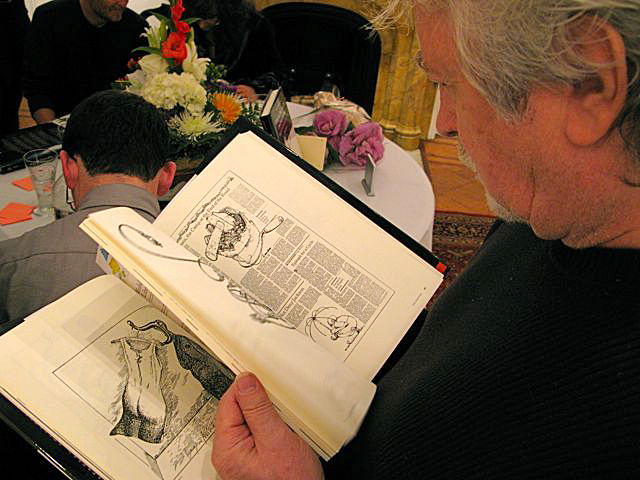 Andy Jurinko taking a look at one of the copies