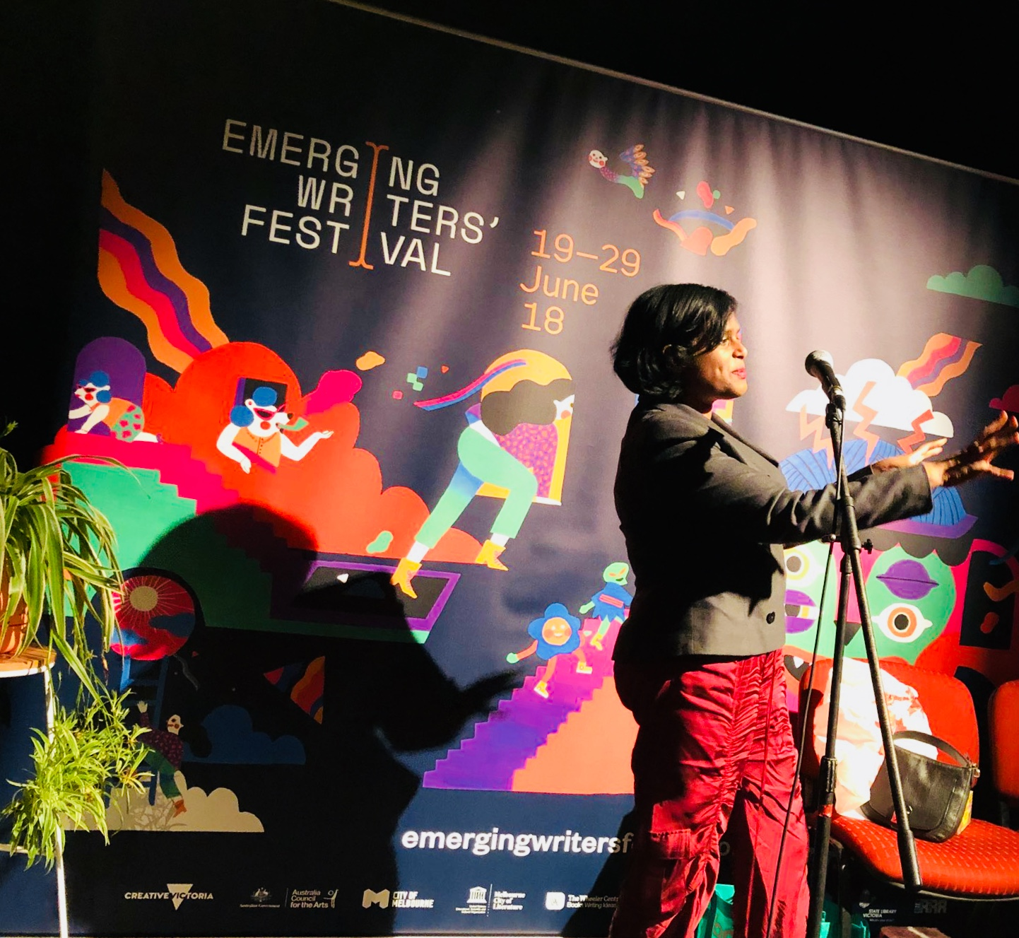 Farah Farouque speaking at Speakeasy: Money event as part of the Emerging Writers Festival 2018 at Brunswick Mechanics Institute in Melbourne.