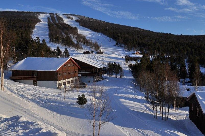 Trolltun gjestegård - Trolltun ligger bare 500 meter fra Dombås skiarena og tilbyr overnatting i hytter, vandrerhjem og hotellrom.