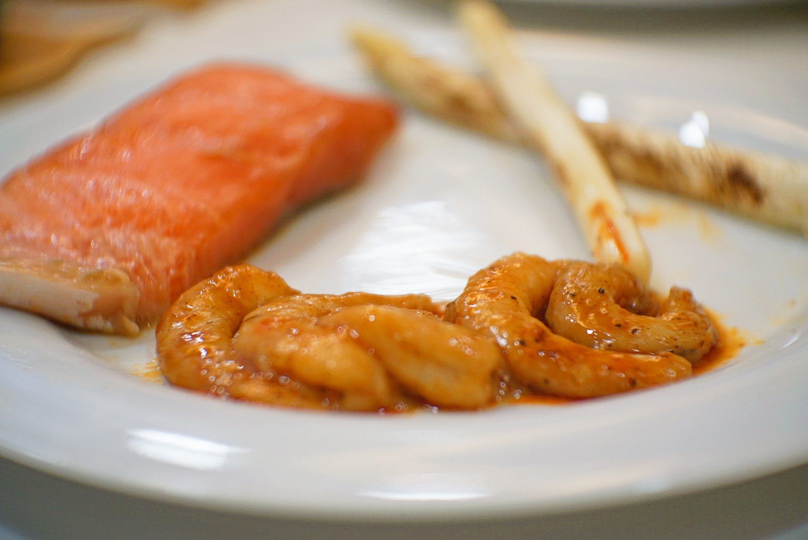 Clockwise from left: soy miso sous vide salmon, air-fried white asparagus and the highlight, Spanish-style sous vide prawns.