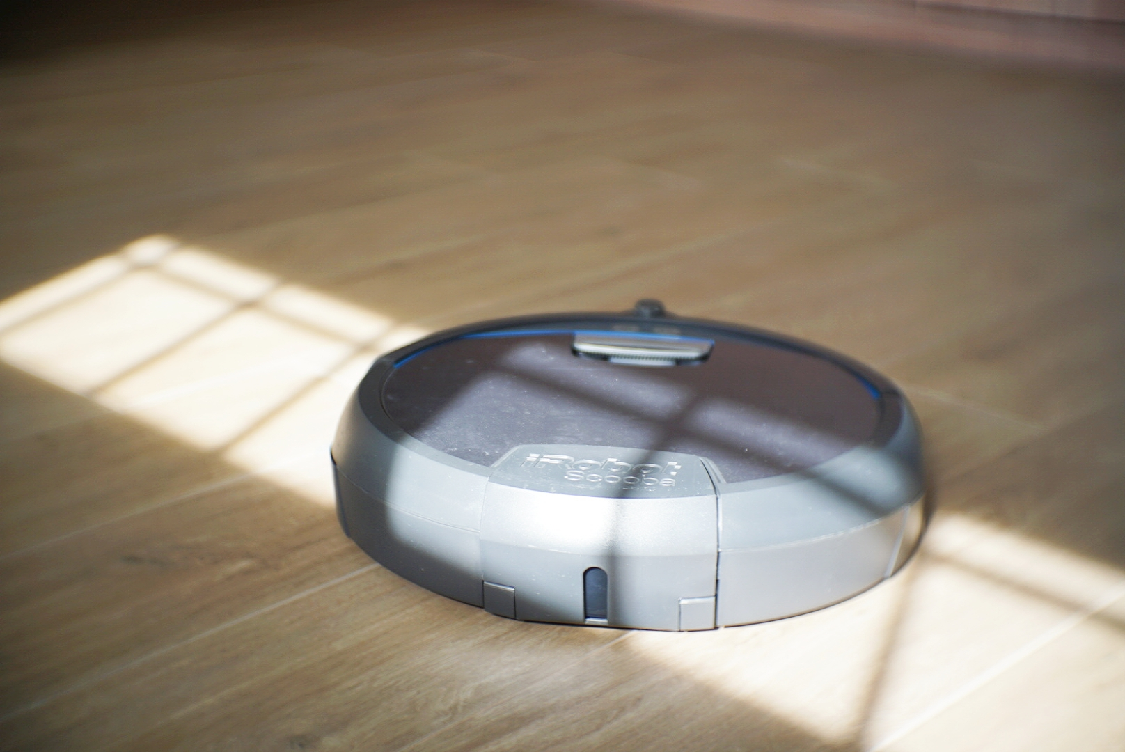 "The iRobot Scooba navigates ""randomly"", and has a front bumper to detect when there's an obstacle."
