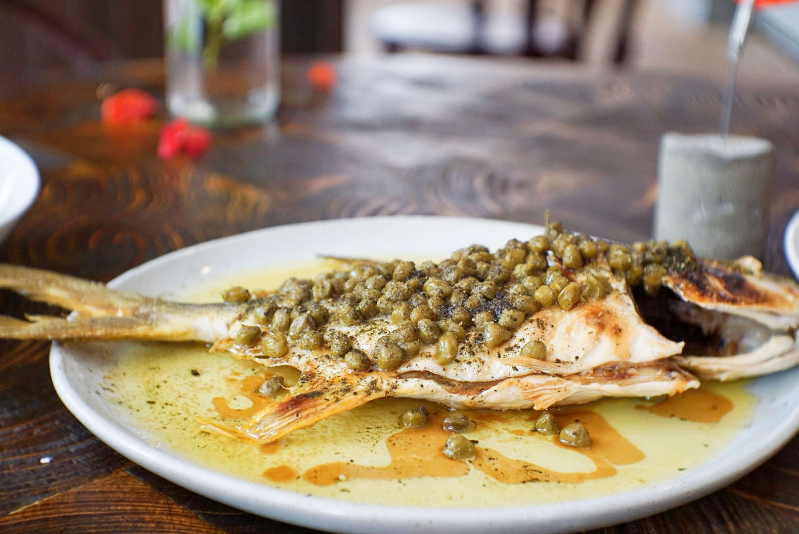 The main course - grilled golden pomfret topped with a generous amount of capers.