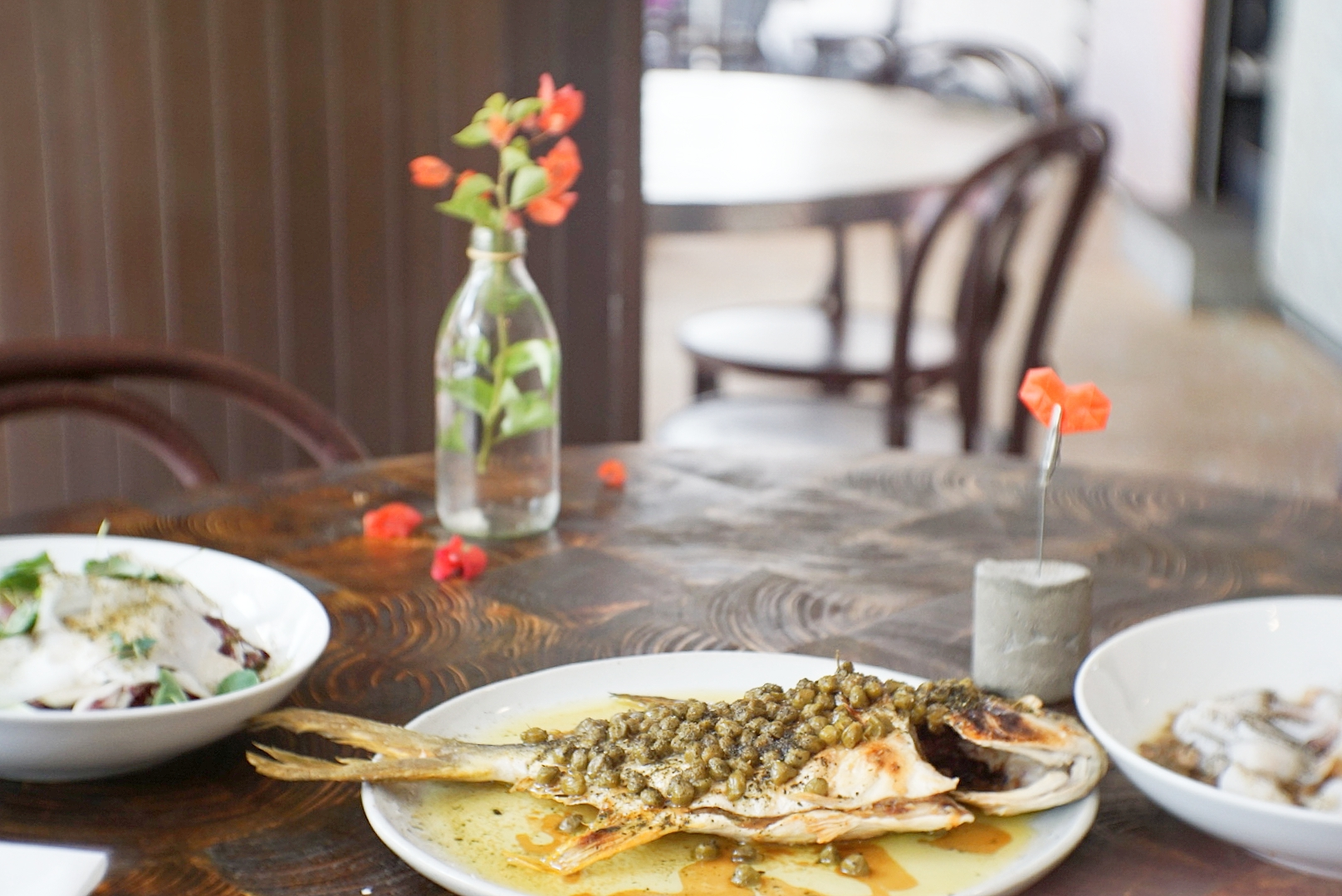The golden pomfret was served together with local greens (to the left) and braised squid (to the right).