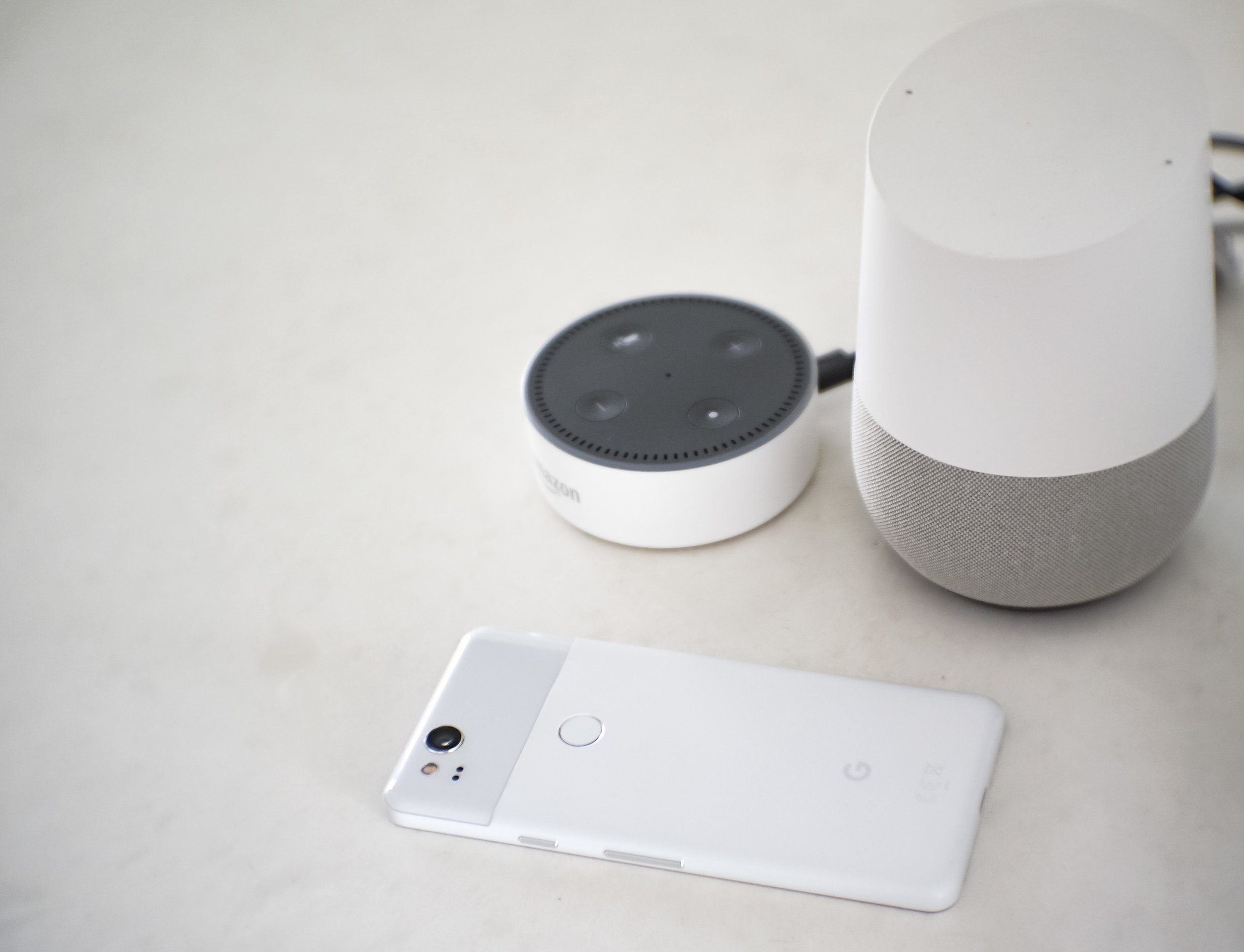 The Google Pixel 2 is smart - just like our  Amazon echo dot (to the left) and Google Home (to the right) .