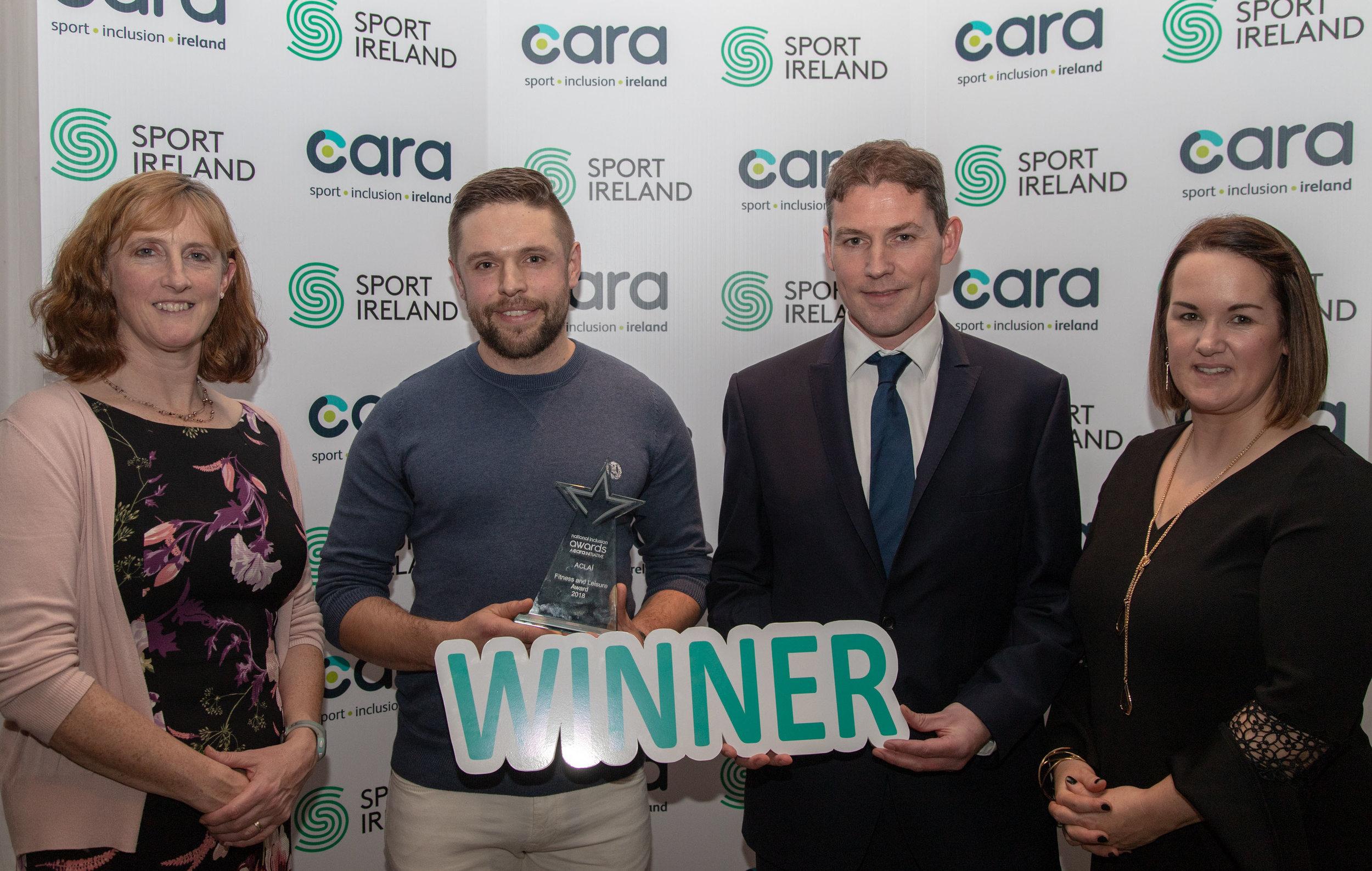 The National Inclusion Awards 2018 - Fitness & Leisure . L-R. Dr Una May ( Sport Ireland) , Winner ACLAÍ - Ainle Ó Cairealláin, Conn McCluskey (presenter)  Niamh Daffy ( Cara)