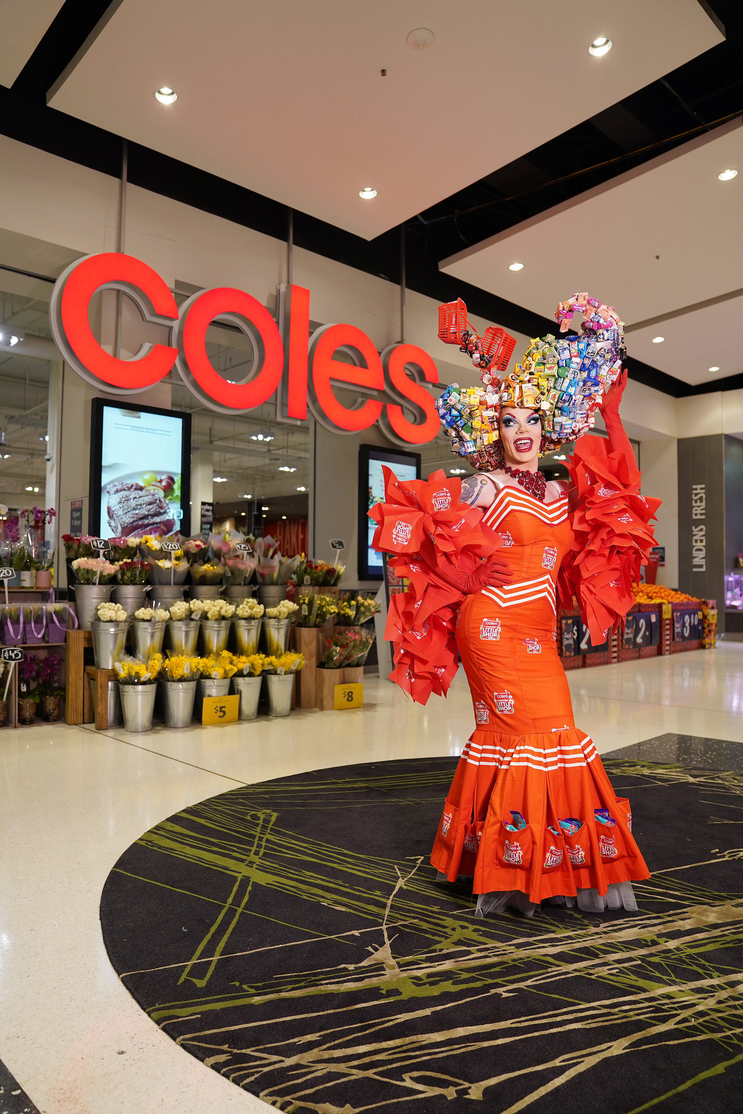 MELBOURNE, AUSTRALIA - AUGUST 17: Art Simone poses in a couture piece inspired by Little Shop 2 mini collectables during the Coles Little Shop swap day at Westfield Southland on August 17, 2019 in Melbourne, Australia. Coles has released a new collection of 30 mini collectables of iconic supermarket products. (Photo by Stefan Postles/Getty Images for Coles)