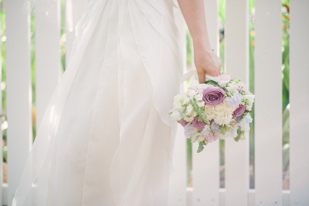 brides bouquet of mauve and white roses with scented spring flowers