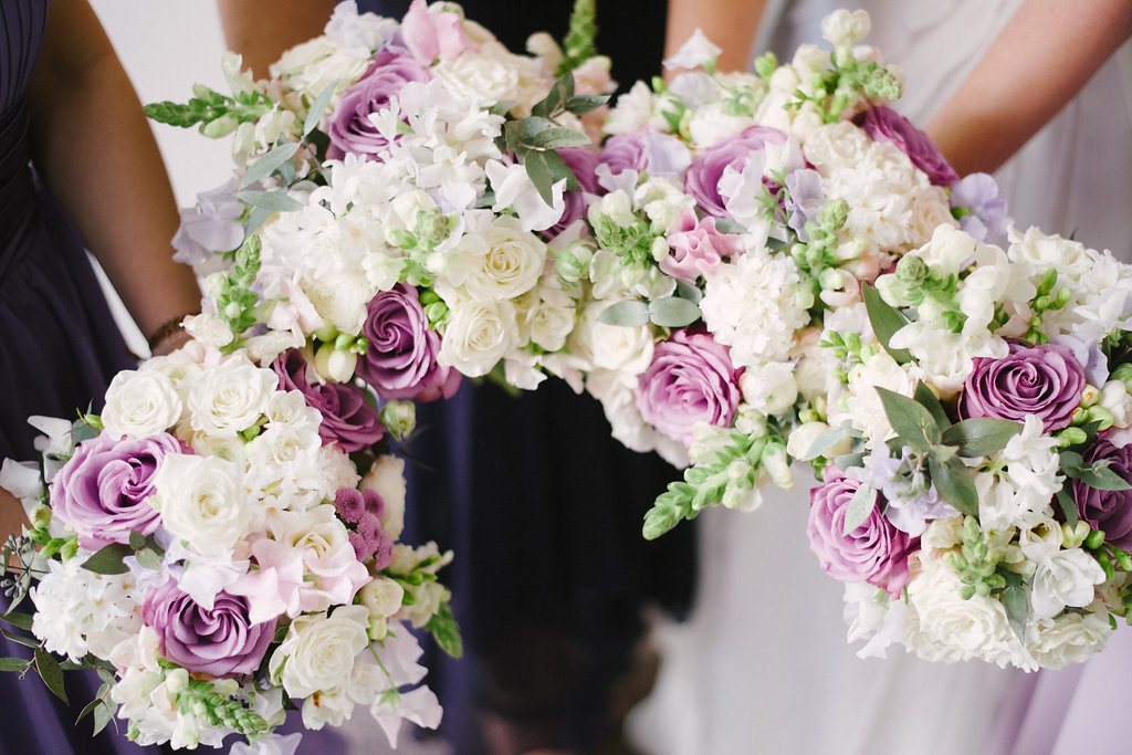 bride and bridesmaids wedding bouquets of spring flowers