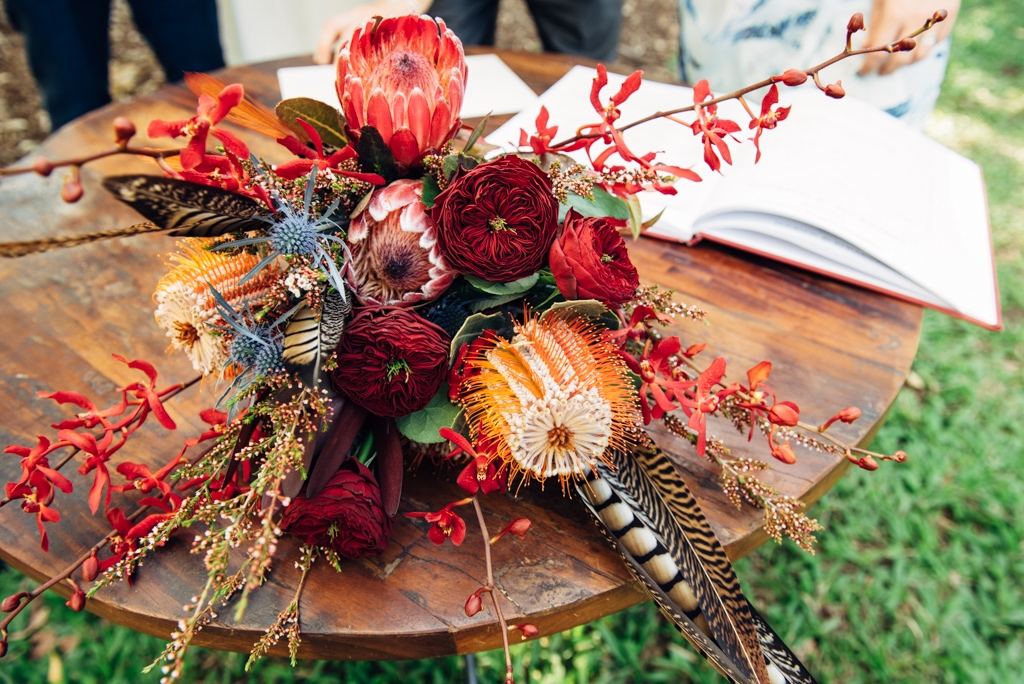 brides bouquet of banksia, protea and pheasant feathers for a bohemian inspired Darwin wedding