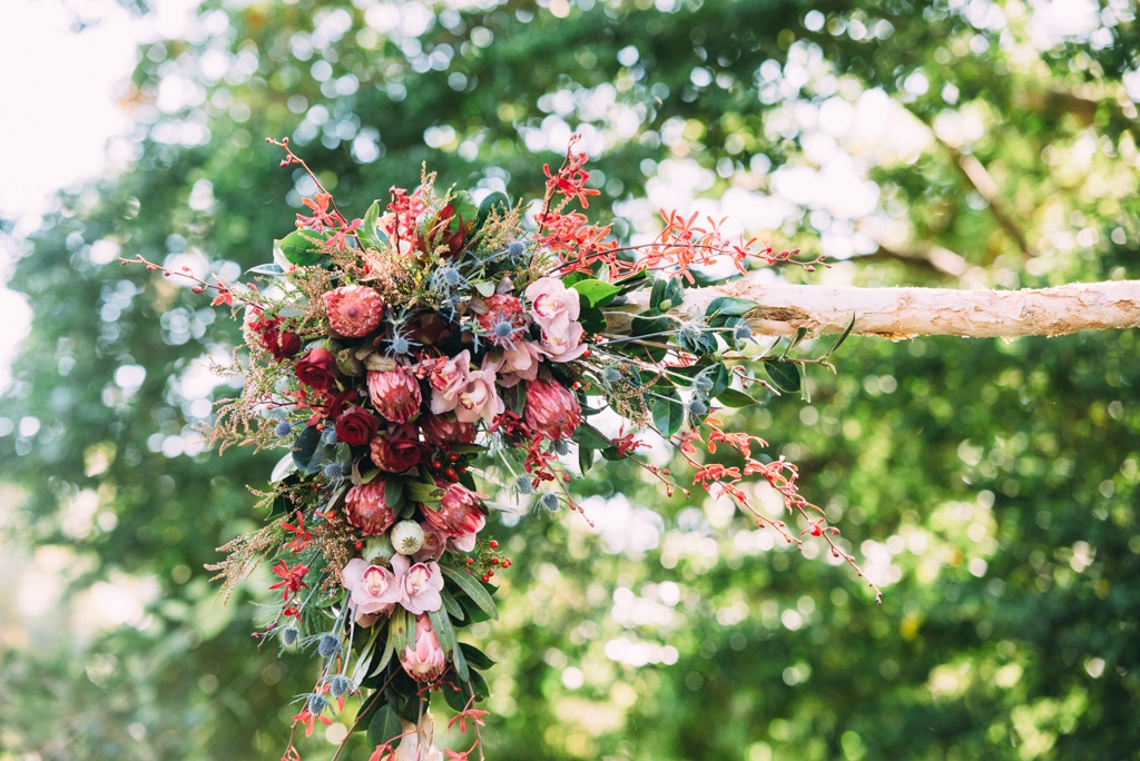 native flowers adorn a paperbark arbour at Darwin wedding