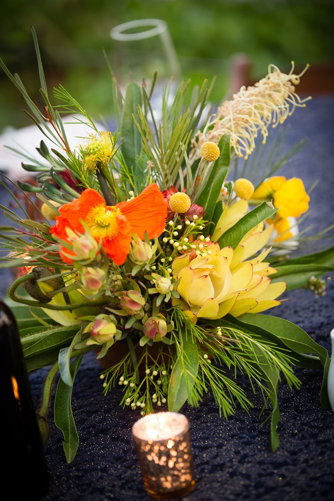 poppies, native flowers including grevillea and leucodendren for table centrepieces