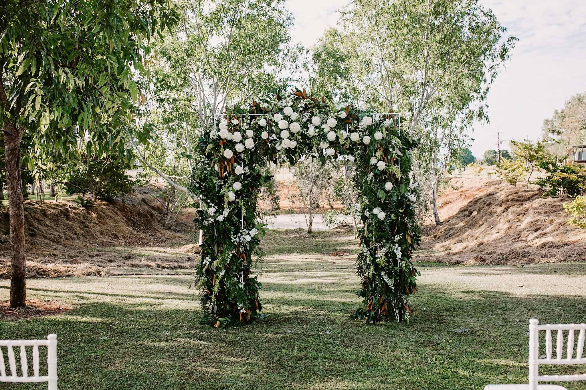 outback wedding ceremony arbour flowers