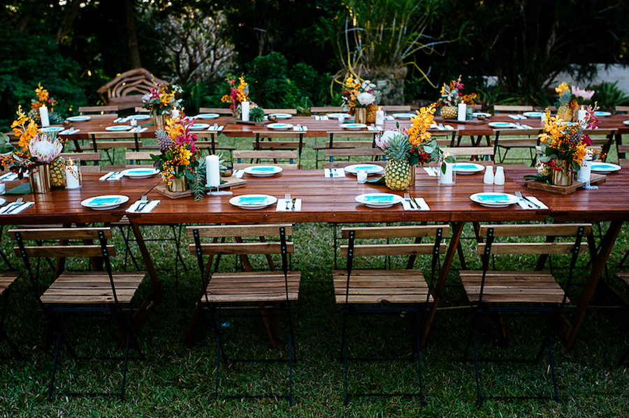 timber table tops with pineapples and flowers at Darwin Botanic Gardens
