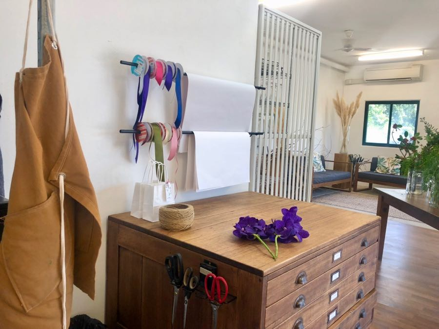 Beija Flor Darwin florist studio, this is our gift wrapping station, our bouquets are wrapped in white tissue and tracing paper. Our antique plan chest came from the recycling store at Shoal Bay and was lovingly restored.