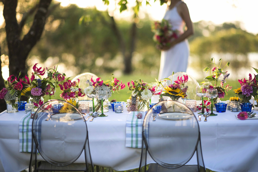 flower filled guest tables overlooking Lake Alexander at East Point