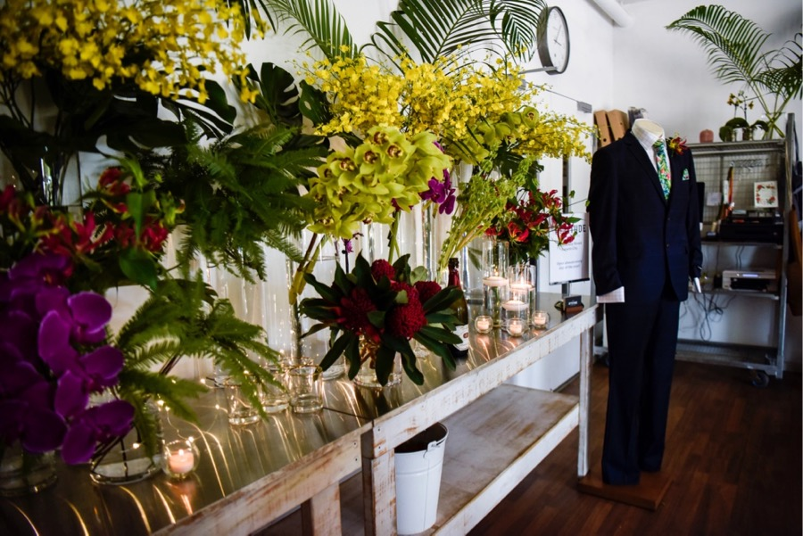 inside Beija Flors Coconut Grove studio, colour popping orchids, interspersed with twinkling candlelight form a stunning tropical backdrop