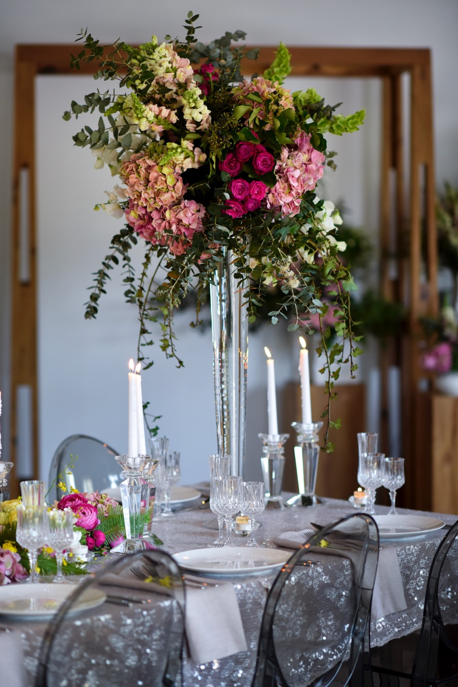 elegant glass vases of summery blooms, perfect for an indoor Darwin wedding reception, created by Beija Flor, Darwin wedding expert florists