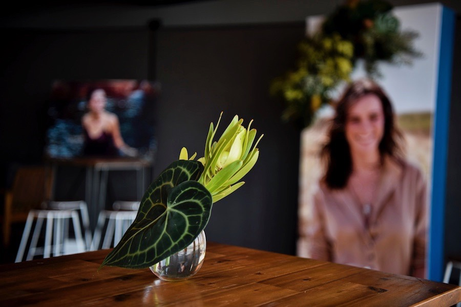 cocktail tables dressed with turtle leaves and leucodendren