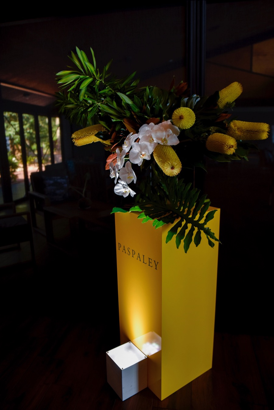 Beija Flor florists created floral arrangements of banksia and phalenopsis orchids to frame the entrance to Pee Wees