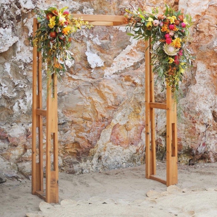 timber arbour dressed with vibrant blooms